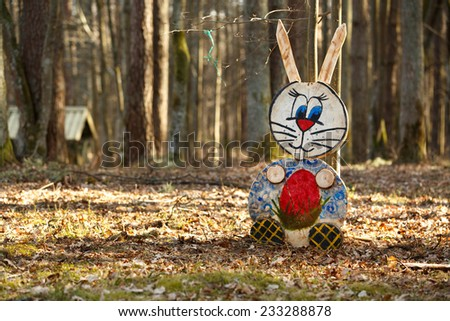 Colorful rabbit figure in the forest - stock photo
