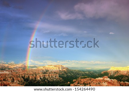 Colorful rainbow above Bryce Canyon National Park, Utah, USA. - stock photo