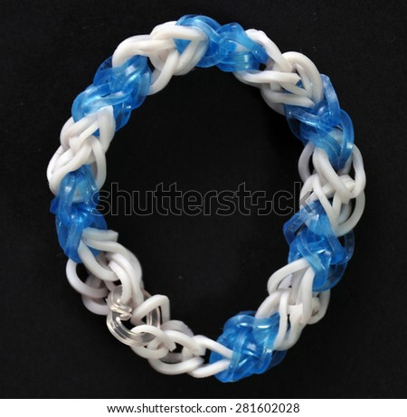 colorful  rainbow colors rubber bands loom bracelet on black background - stock photo