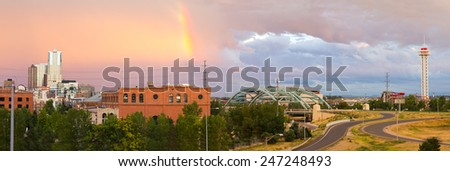 Colorful rainbow in the sky above Denver, Colorado
