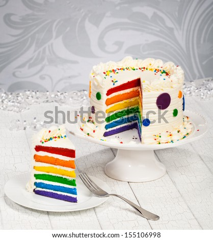 Colorful rainbow layered birthday cake.  - stock photo