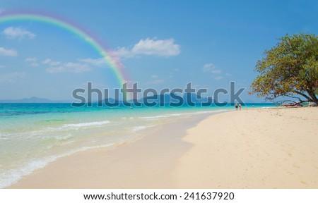 Colorful rainbow over a Tropical beach of Andaman Sea, Thailand. - stock photo