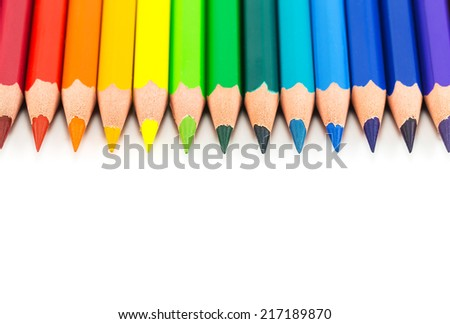 colorful rainbow pencils on a white background, close up - stock photo