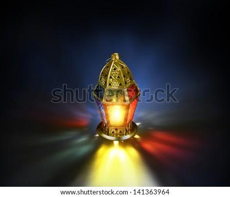 Colorful ramadan lantern on black background - stock photo