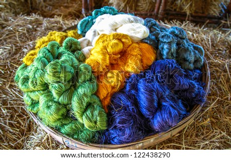 Colorful raw silk thread background - stock photo