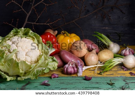 Colorful raw vegetables, healthy cooking ingredients on rustic wooden table. - stock photo