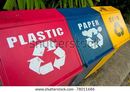 Colorful recycle bins for plastic, paper and metal waste for environment conservation. - stock photo
