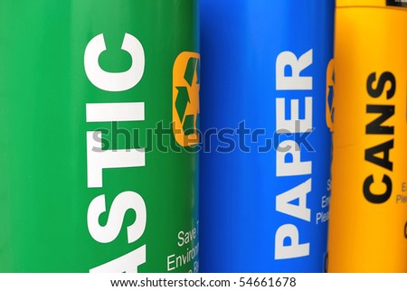 Colorful recycle bins for recyclable materials such as plastic, paper and metal. For environmental conservation, global warming and eco energy concepts. - stock photo