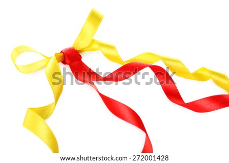Colorful red and yellow ribbons with bow isolated on white - stock photo