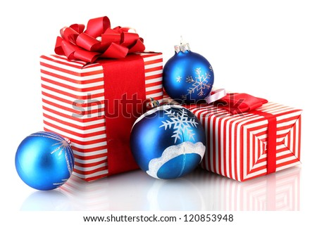 Colorful red gifts with blue Christmas balls isolated on white - stock photo