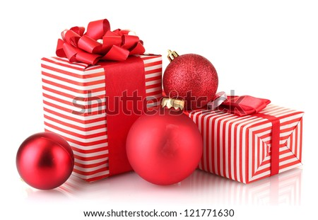 Colorful red gifts with Christmas balls isolated on white - stock photo