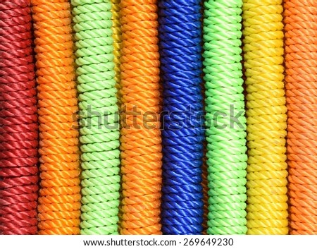 Colorful red, green, blue & orange nylon ropes - stock photo