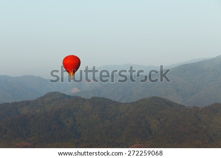 colorful red hot air balloon in sky of Laos - stock photo