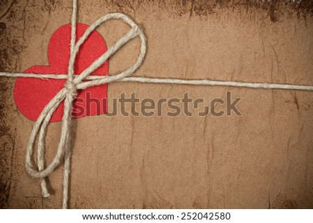 Colorful  red paper heart on vintage paper with copyspace. Valentine's Love concept - stock photo