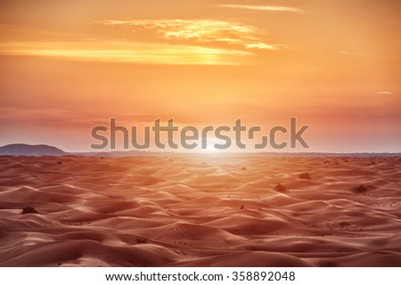 Colorful red sunset over desert - stock photo