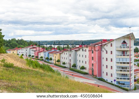 Colorful residential neighborhood surrounded by nature. Modern living. - stock photo