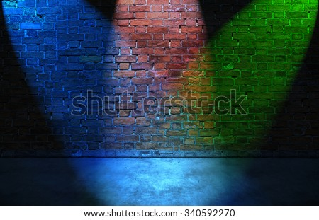 Colorful RGB spot lights on old brick wall - stock photo