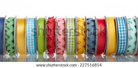 colorful ribbon rolls on white  - stock photo