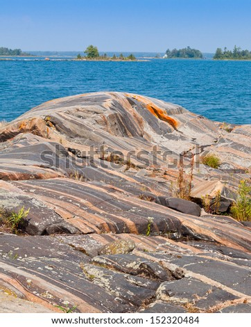 Colorful rock formations in Georgian Bay, Lake Huron, Ontario - stock photo