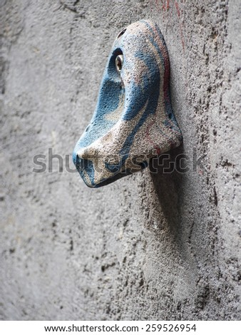 Colorful rock on rock climbing wall - stock photo