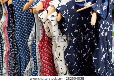 Colorful Rockabilly polka dot dresses on hangers display                                - stock photo