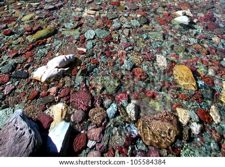 Colorful rocks on a stream bed at Glacier National Park - stock photo