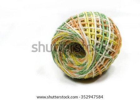 colorful roll of jute, string, hemp rope isolated on white background
