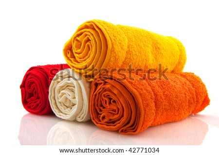 colorful rolled towels in yellow red and orange