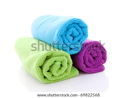 colorful rolled towels over white background