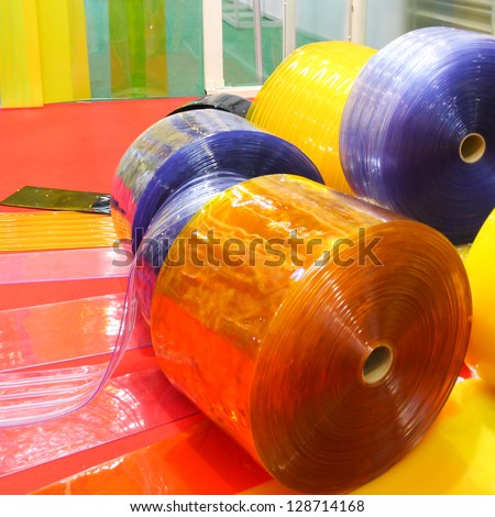 Colorful rolls of pvc sheet - stock photo
