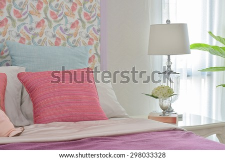 Colorful romantic bedding style with beautiful pattern headboard and crystal base reading lamp