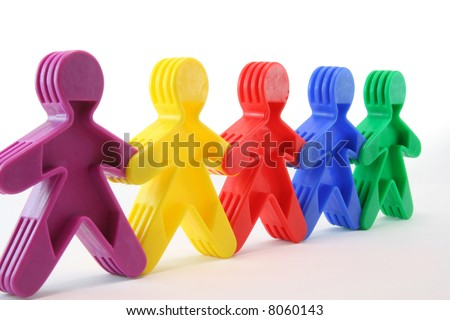 Colorful row of toy people - stock photo