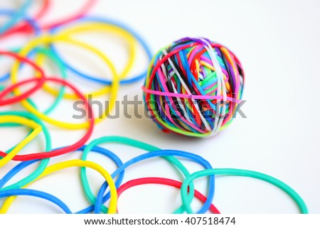 Colorful rubber band ball on white background - stock photo