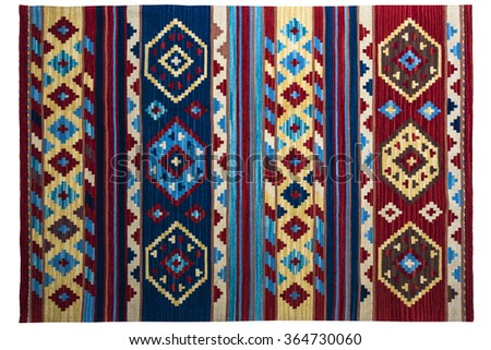 Colorful rug with oriental ornaments isolated on white background - stock photo