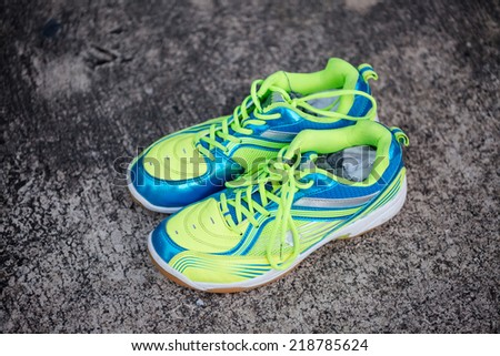 Colorful Running shoes on dark cement floor - stock photo
