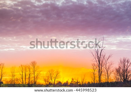 colorful rural sunset in late autumn season