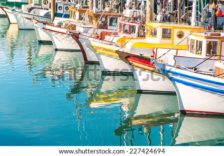 Colorful sailing boats at Fishermans Wharf of San Francisco Bay - California - United States - stock photo