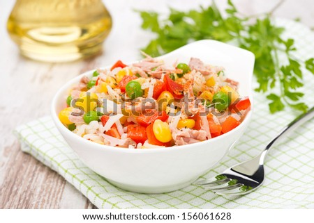 colorful salad with corn, green peas, rice, red pepper and tuna, close-up, horizontal - stock photo