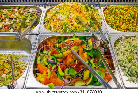 Colorful salads at a buffet in a restaurant - stock photo