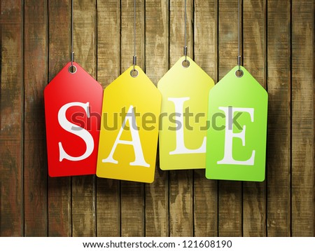 Colorful sale tags hanging on wooden background - stock photo