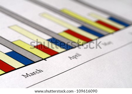Colorful sales charts with ball pen. - stock photo