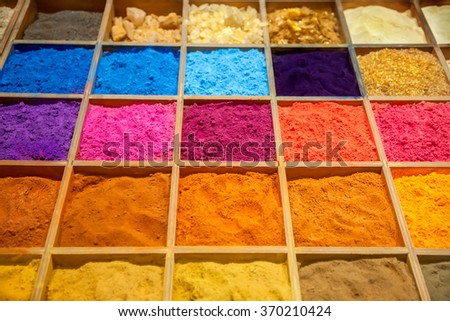 Colorful sands in wooden box - stock photo