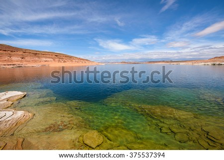 Colorful sandstone rocks at Lake - Sandstone rocks, on the shore and under water, of Lake Powell. Glen Canyon National Recreation Area, Page, Arizona, USA. - stock photo
