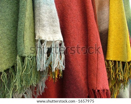 colorful scarfs and plaids hanging - stock photo