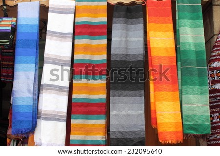 Colorful scarves hanging in a market stall in Morocco - stock photo