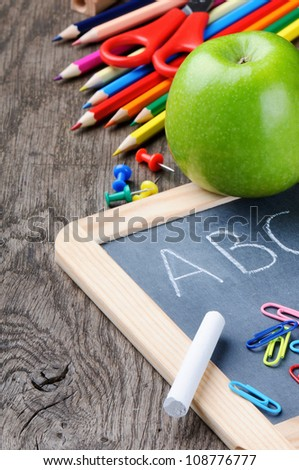 Colorful school supplies on wooden desk