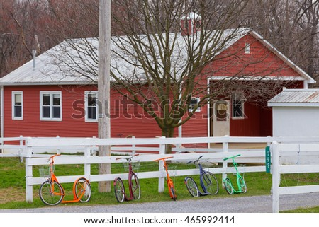 Colorful scooters lined up at Amish School