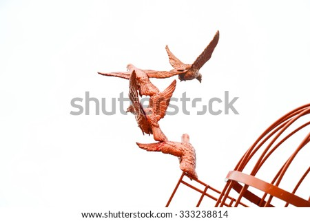 colorful Sculpture of a Dove Being Set Free - stock photo