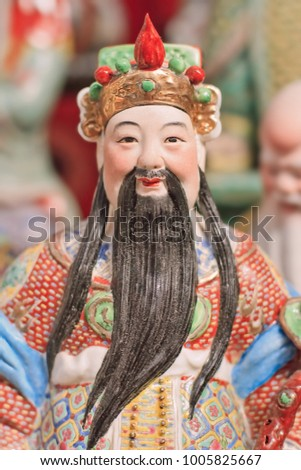 Colorful sculpture of an ancient Chinese noble on Panjiayuan flea market, Beijing, China.