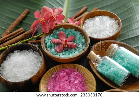 colorful sea salt ,flower in wooden bowl with cinnamon, on banana leaf  - stock photo